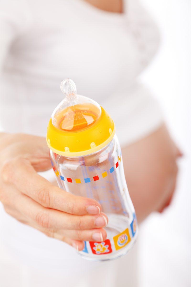 Mom holding baby bottle