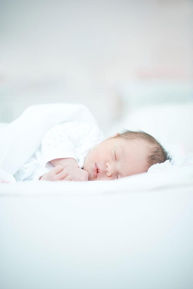 newborn baby fast asleep