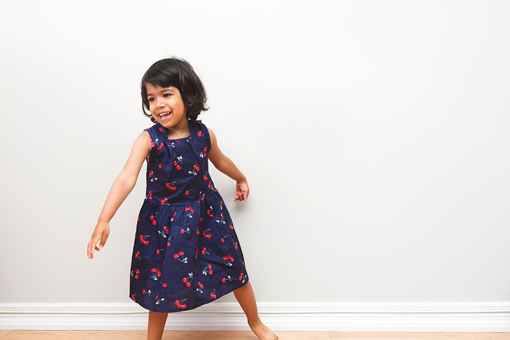 Toddler girl wearing floral dress
