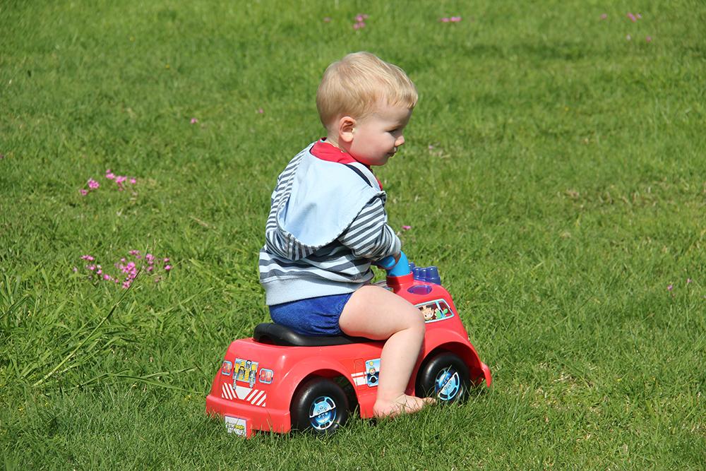 2 year old toddler riding a bike