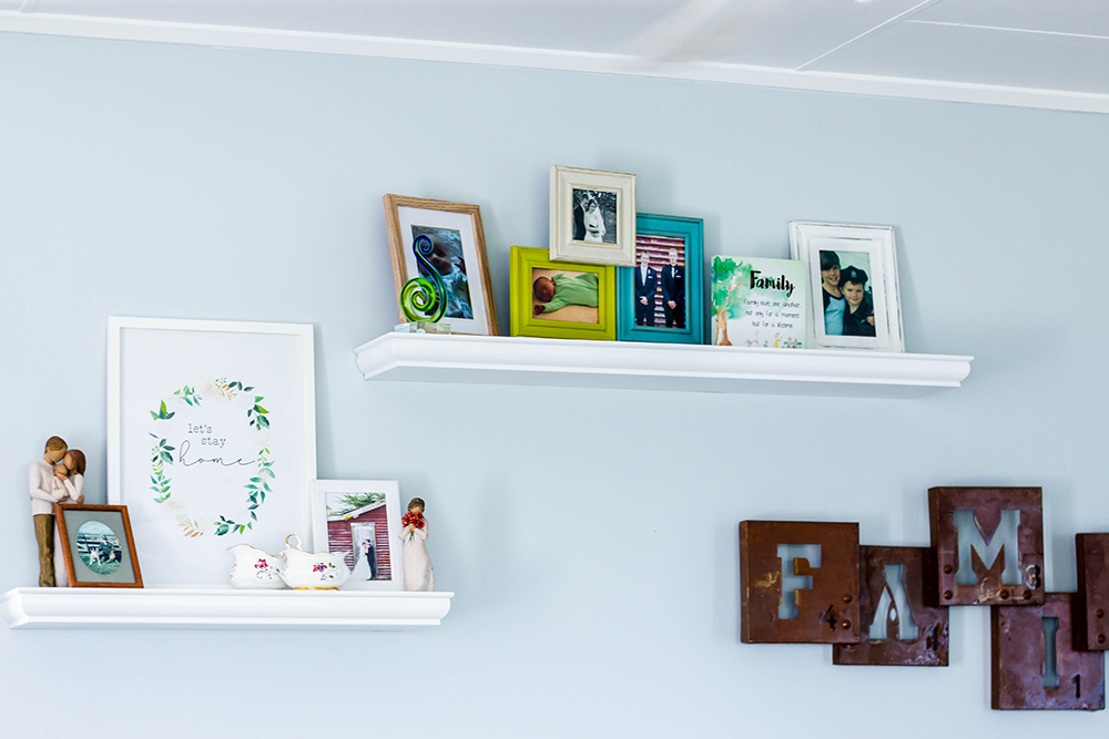 Shelves with frames on them