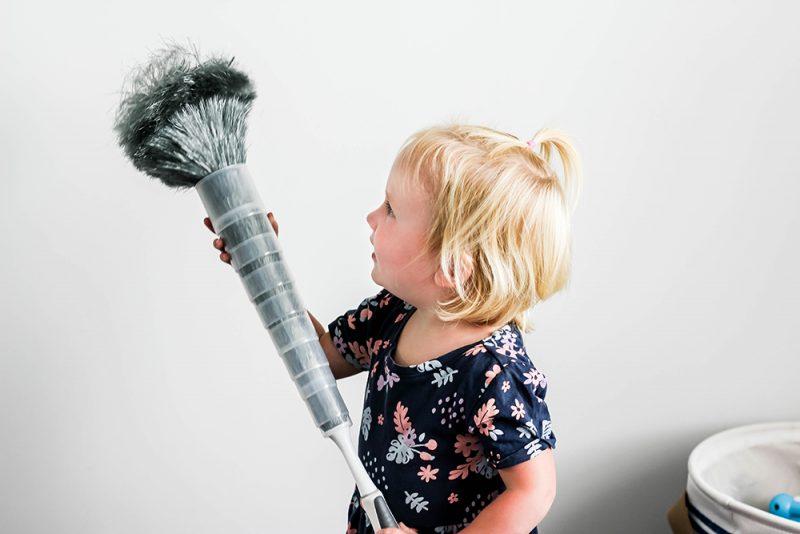 Toddler girl dusting