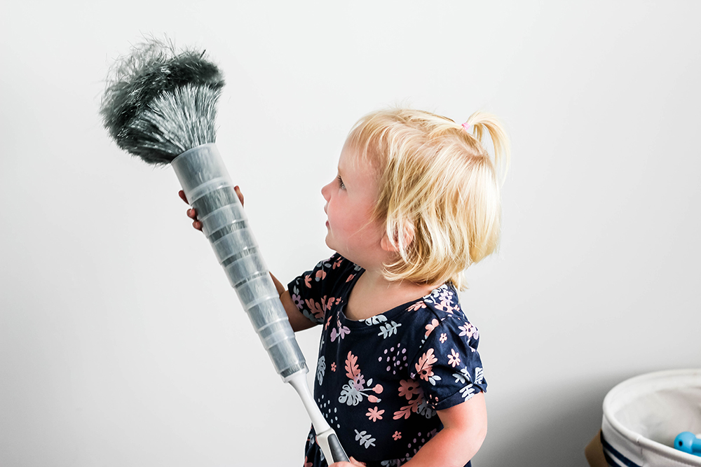 Toddler girl dusting