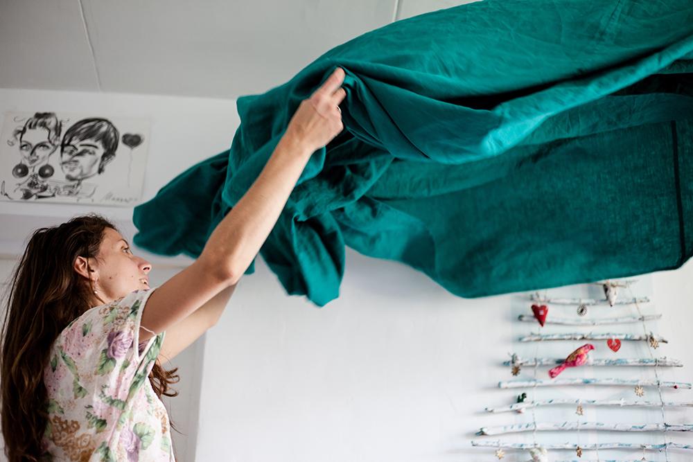Woman shaking out sheet