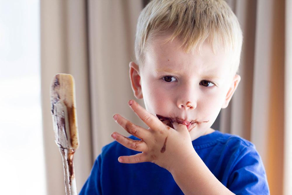 4 year old boy eating cake batter