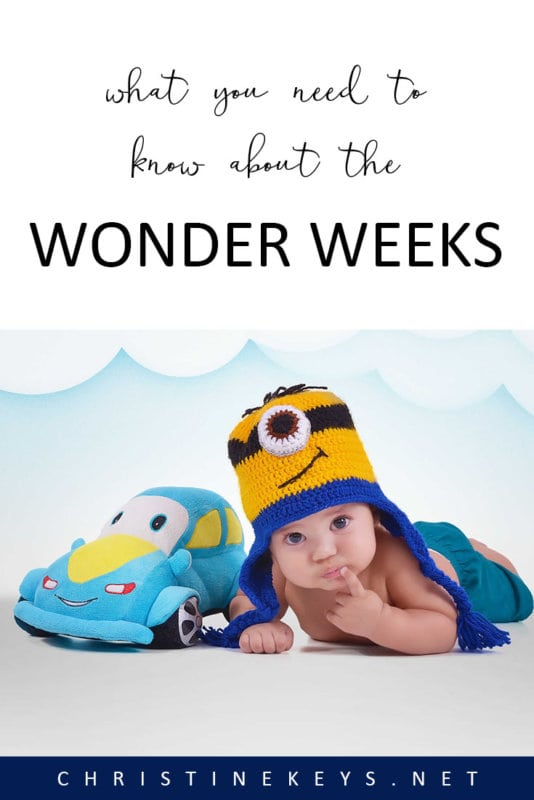 Baby lying on tummy with minion hat on
